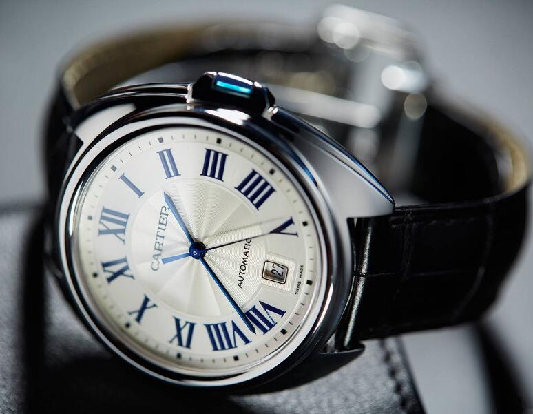 The blue hands and hour markers are striking on the silver dial.
