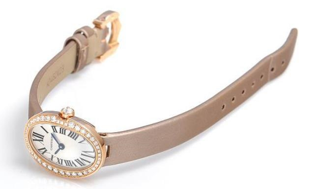 The female copy watches have off-white spun silk straps.
